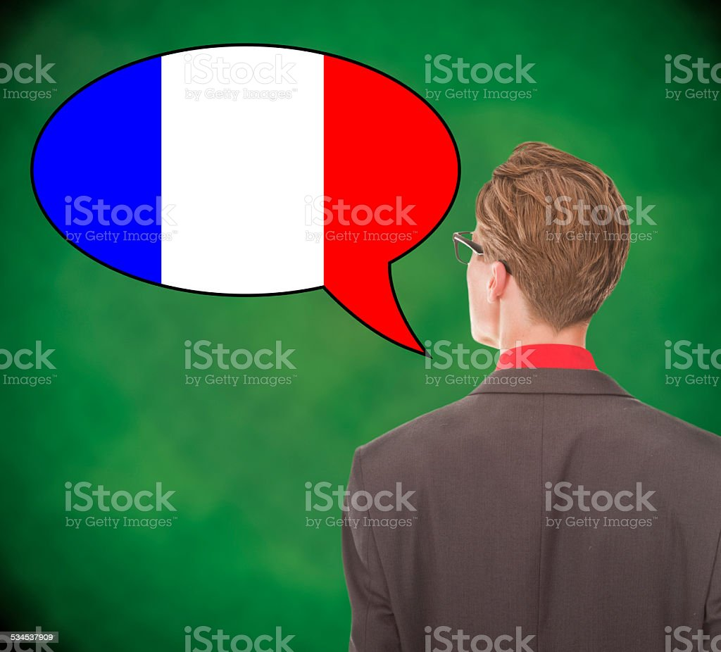 Young business man speaking french on school board background stock photo