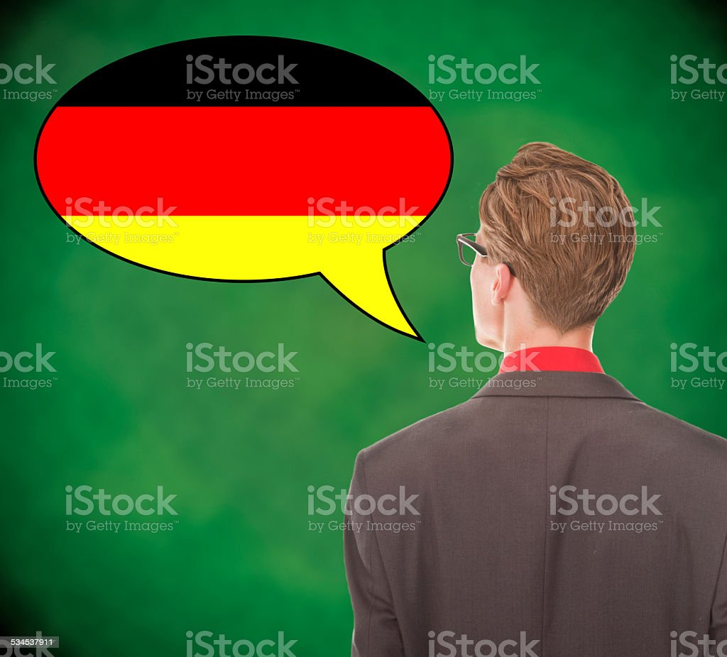Young business man speaking german on school board background stock photo