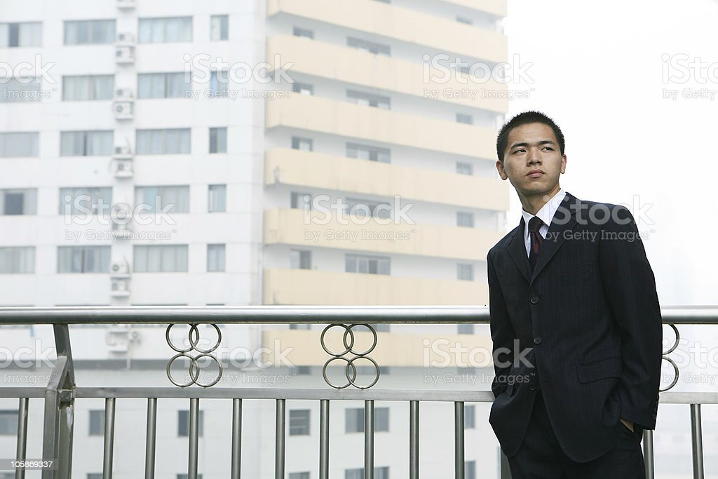 young business man standing before building royalty-free stock photo