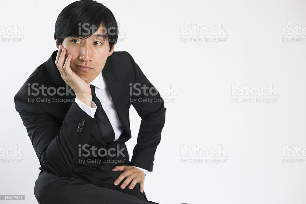 young business man thinking with head in hands royalty-free stock photo