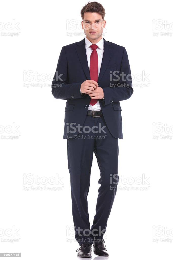 young business man walking on isolated background. stock photo