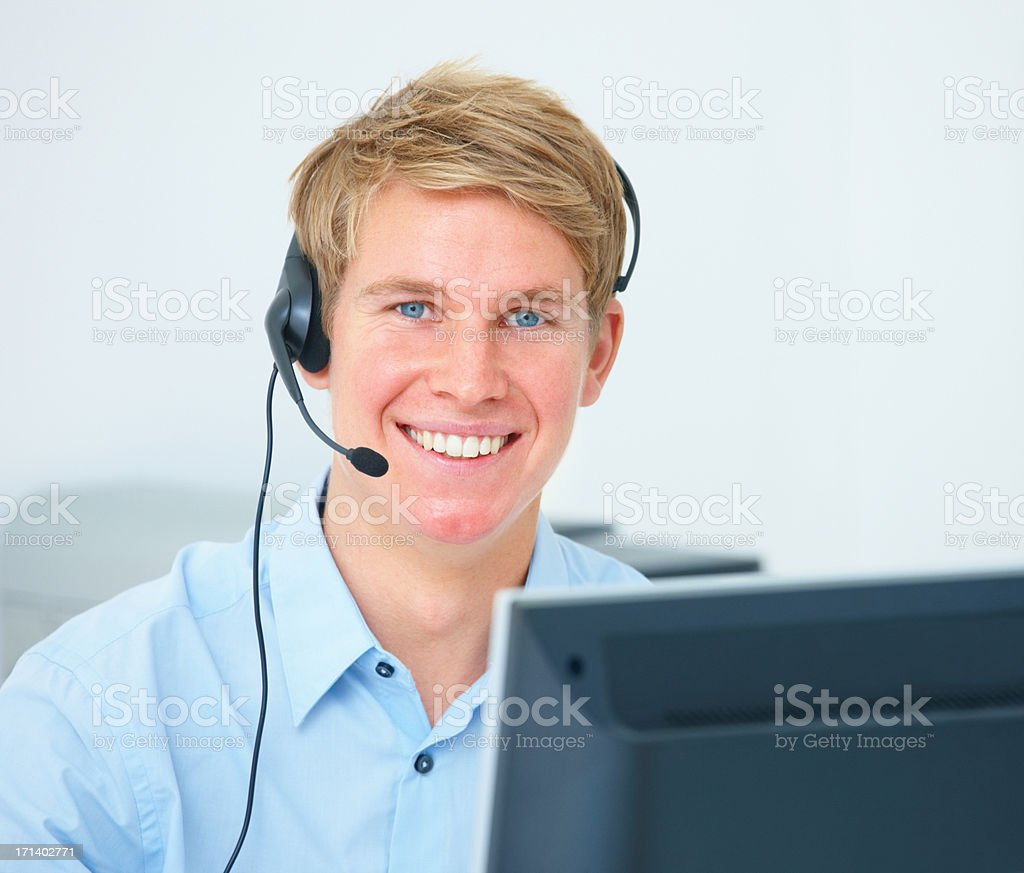 Young business man wearing headset and smiling royalty-free stock photo
