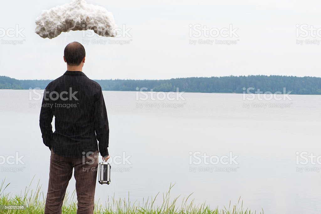 young business man with briefcase and storm cloud, concept stock photo