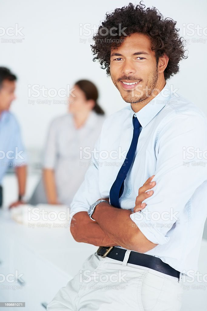 Young business man with his colleagues in discussion at the background stock photo