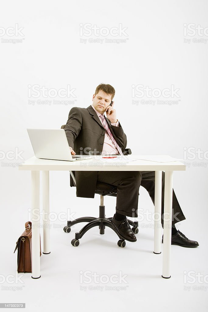 Young business man working in office royalty-free stock photo
