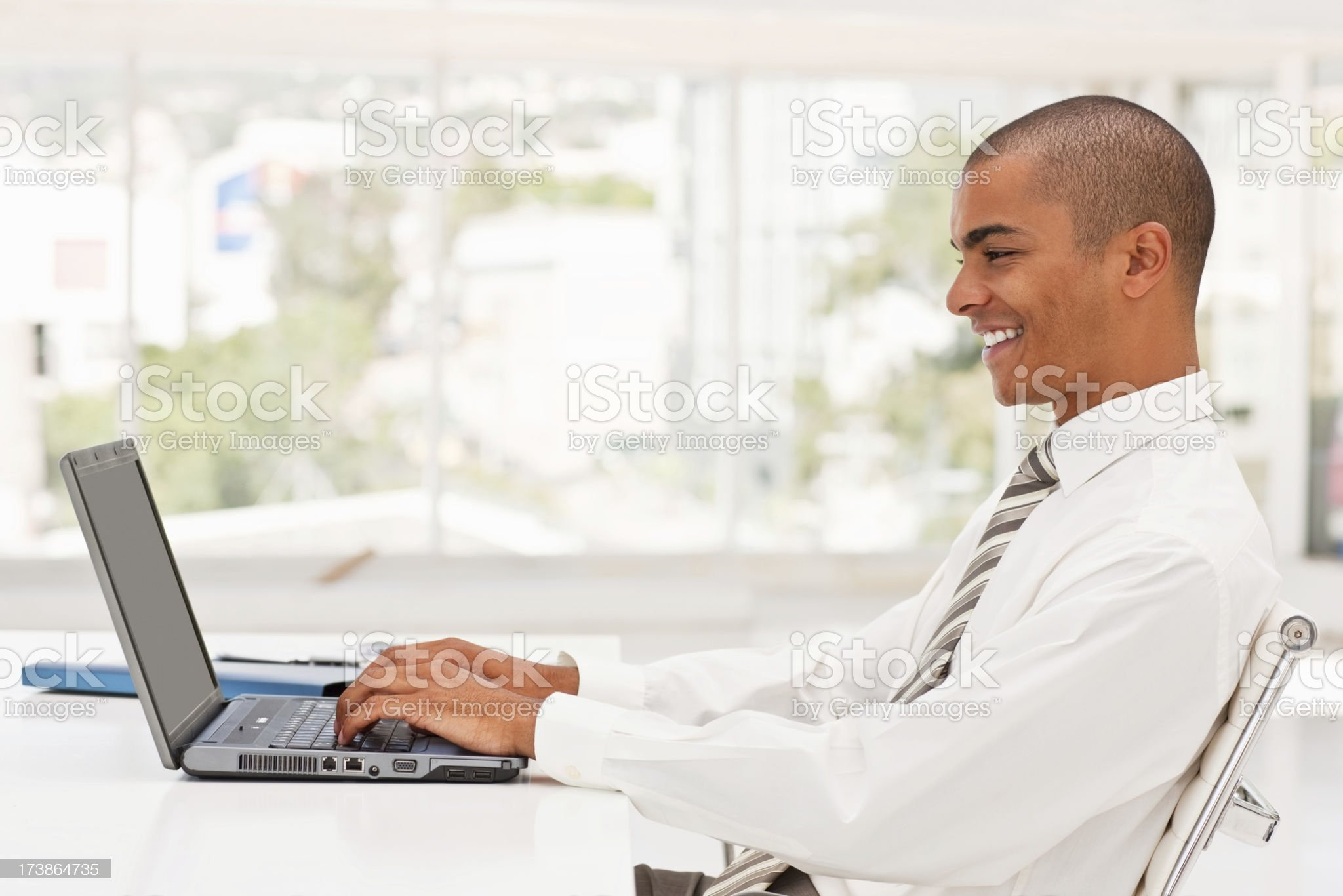 Young business man working on a laptop royalty-free stock photo