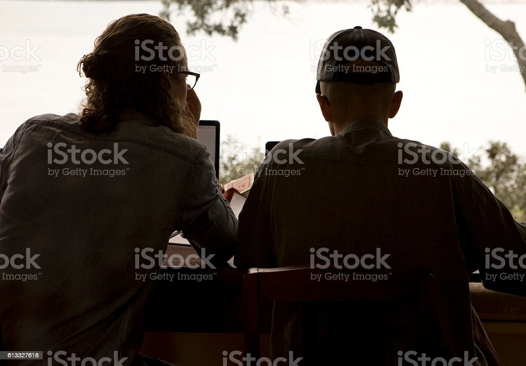 Young business men collaborate stock photo