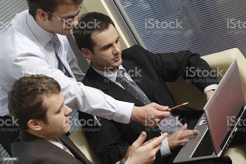 Young business men working with latop in office royalty-free stock photo