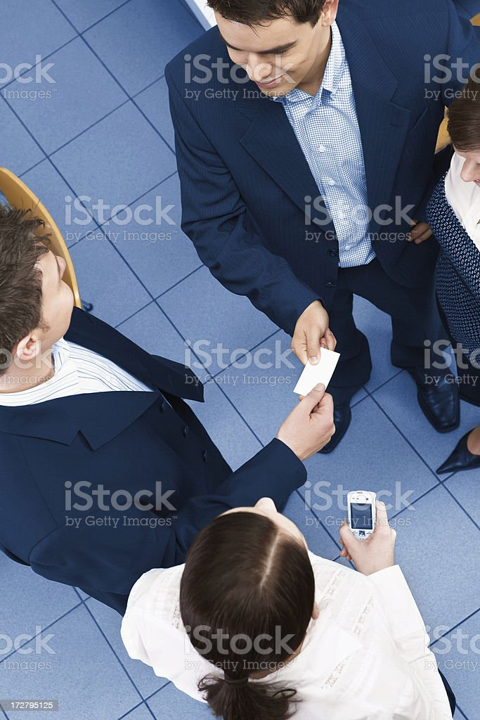 Young business partners having meeting in the office and exchang stock photo