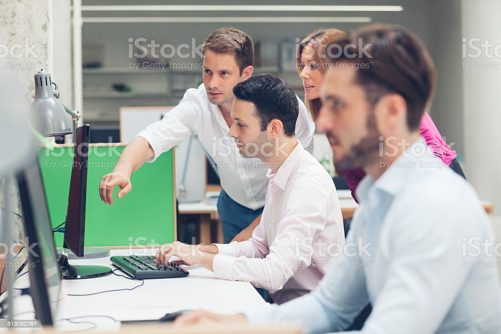 Young Business People Collaborate. stock photo