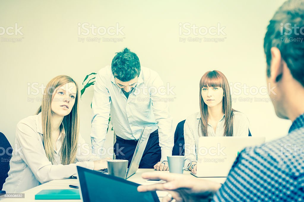Young business people employee workers in moment of tough crisis stock photo