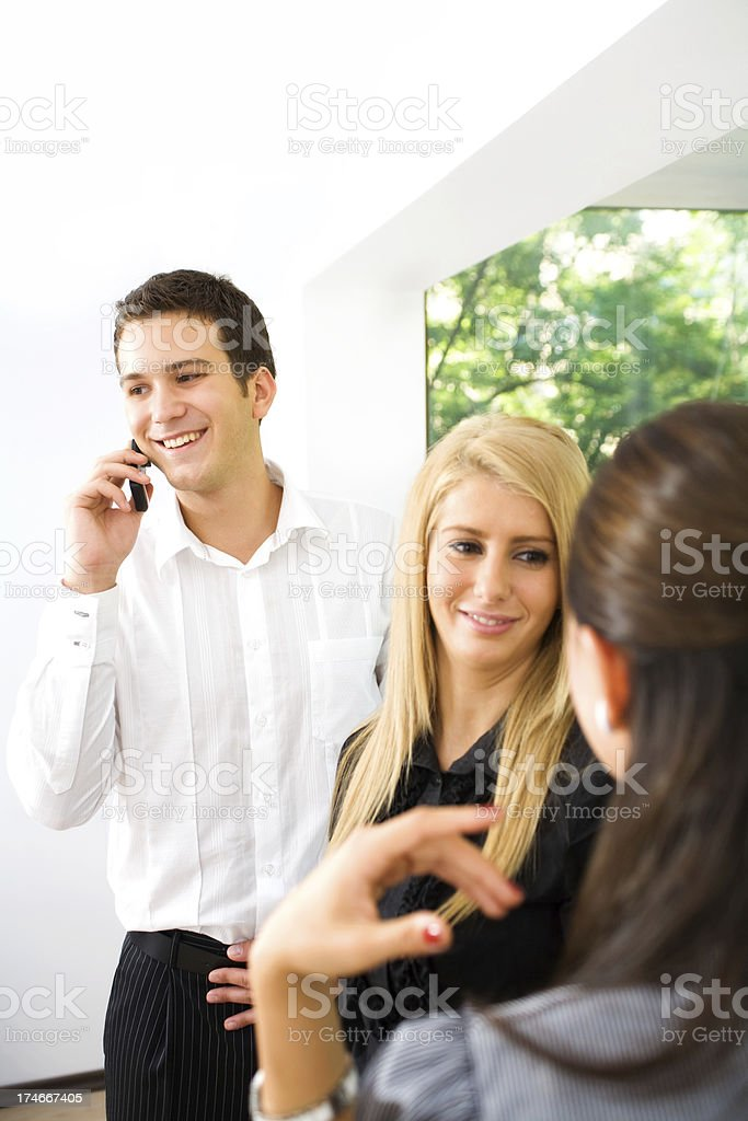 Young business people having conversations royalty-free stock photo