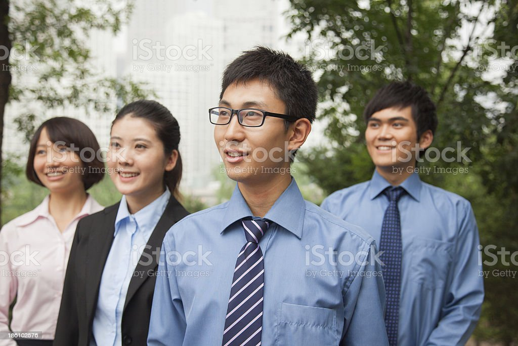 Young business people in the park, portrait royalty-free stock photo
