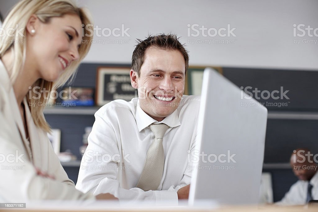 Young business people looking at laptop royalty-free stock photo