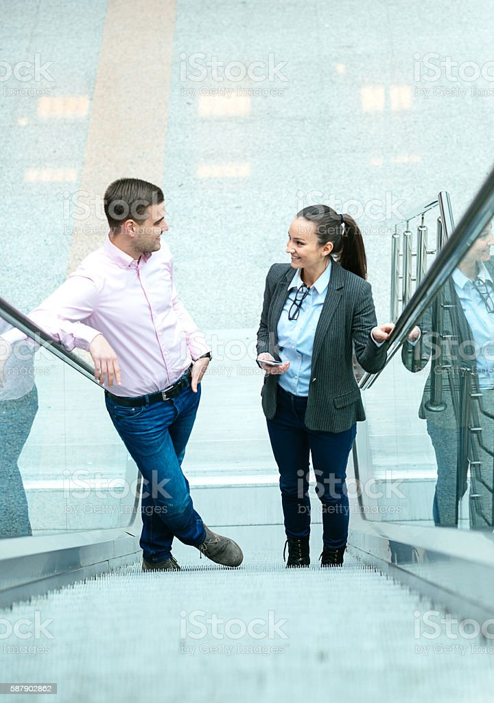 Young business people moving up in career on success ladders stock photo