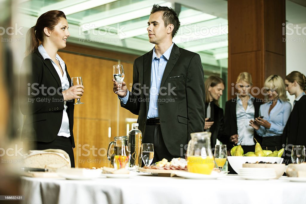 Young business people toasting royalty-free stock photo