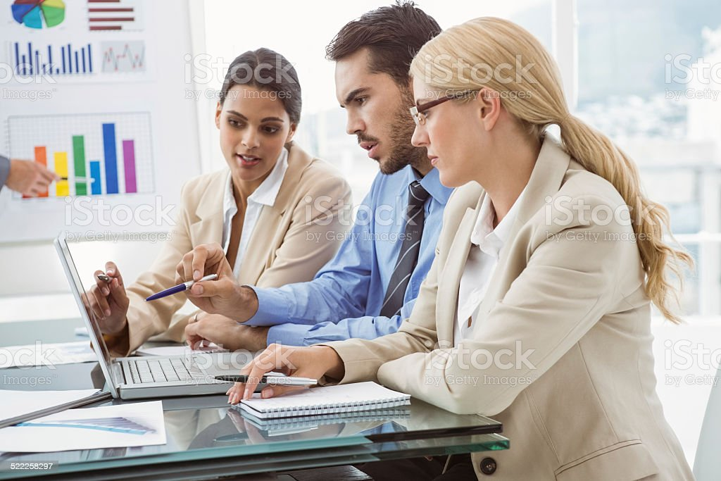 Young business people using laptop stock photo