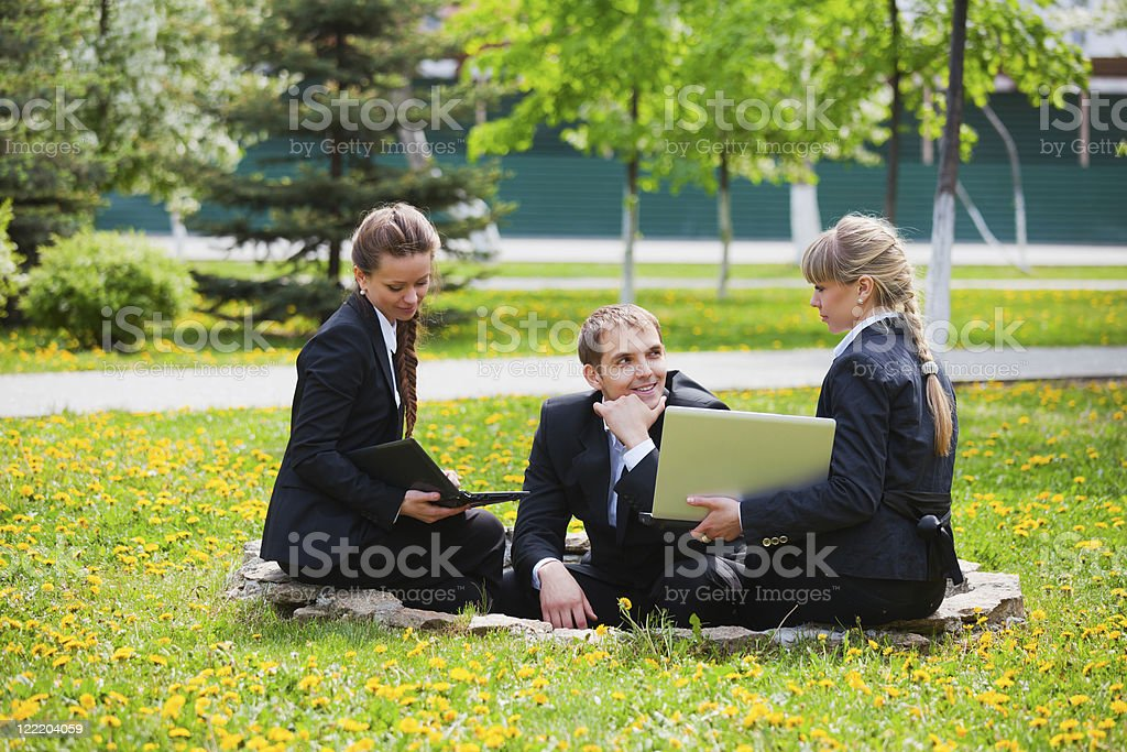 Young business people with laptop royalty-free stock photo