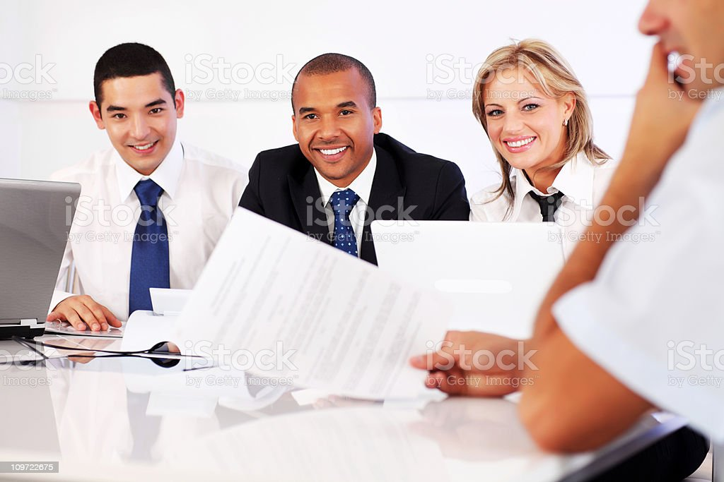 Young business people work with paperwork in the office. royalty-free stock photo