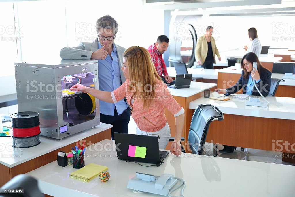 Young Business People working in 3D printer office stock photo