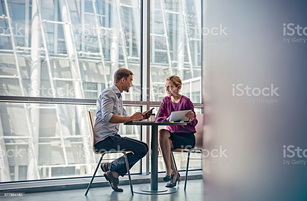 Young Business people working in modern lobby stock photo