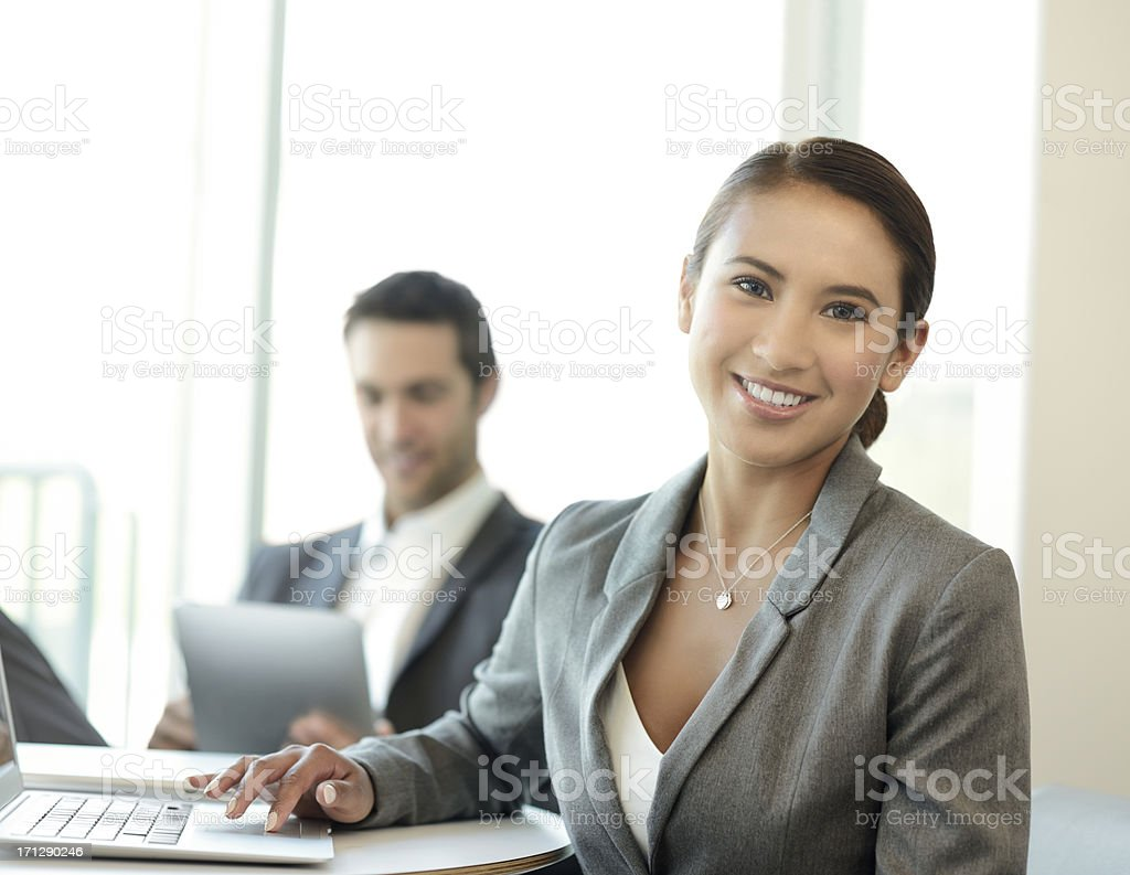Young Business People Working on Digital Devices stock photo