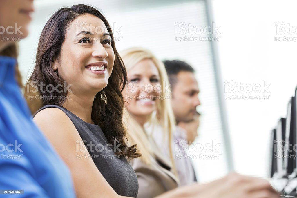 Young business professionals taking computer training course stock photo