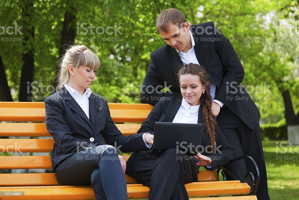 Young business team with laptop royalty-free stock photo