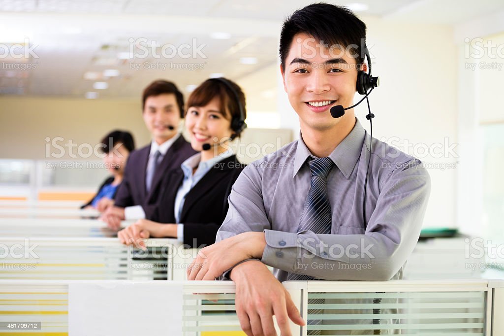 young business team working with headset in office stock photo
