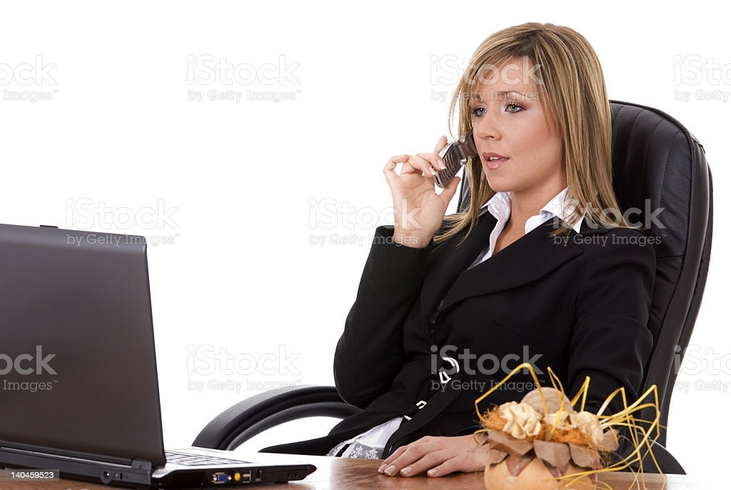 Young business woman at the desk royalty-free stock photo