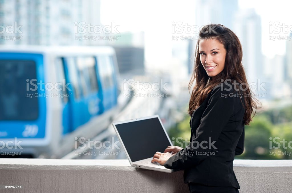 Young Business Woman Catching Tram royalty-free stock photo