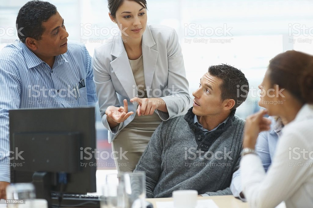 Young business woman explaining a project to colleagues royalty-free stock photo