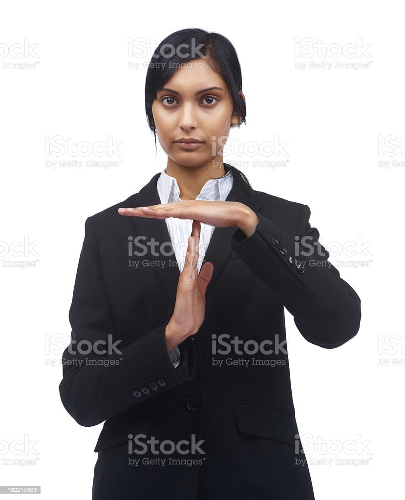 Young business woman gesturing a time out symbol stock photo