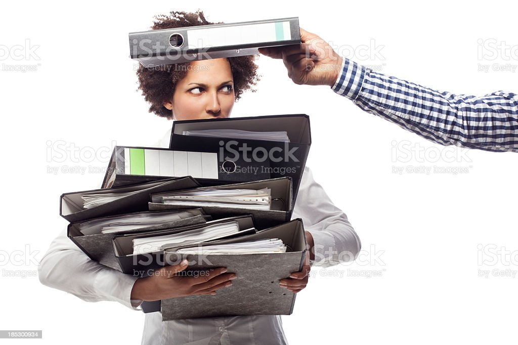 Young business woman getting more work royalty-free stock photo