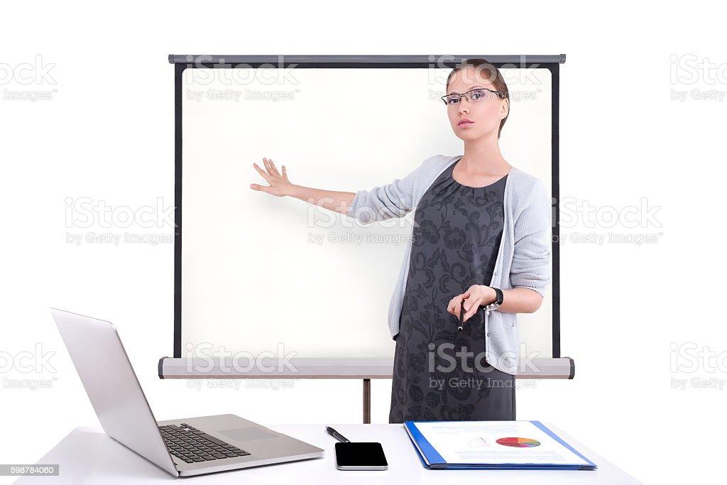 Jeune femme d'affaires donnant une présentation photo libre de droits