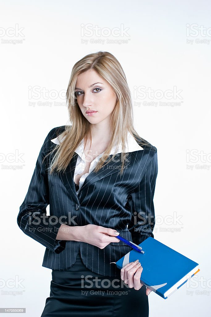Young business woman holding a book royalty-free stock photo