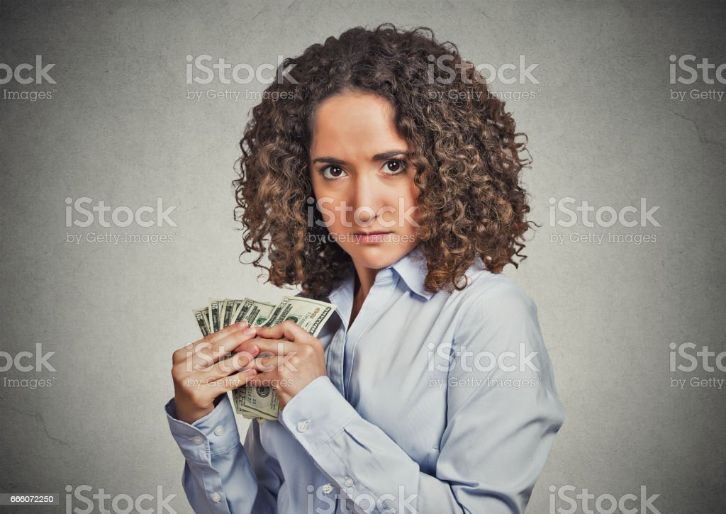 young business woman holding money dollar bills in hand stock photo