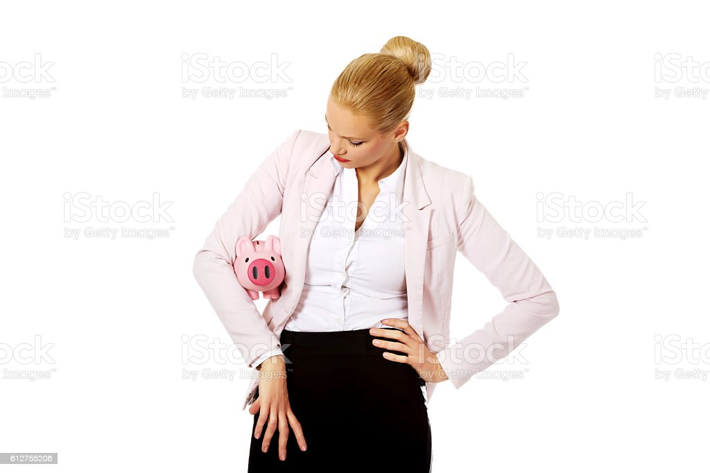 Young business woman holding piggybank stock photo