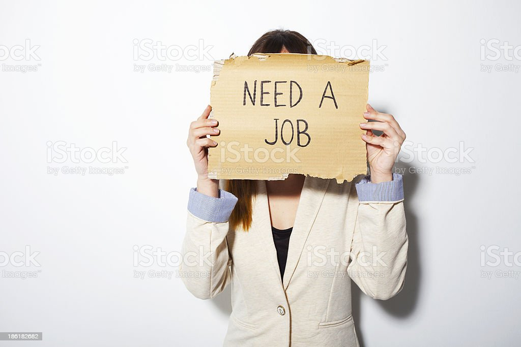 Young business woman holding poster that says need a job royalty-free stock photo