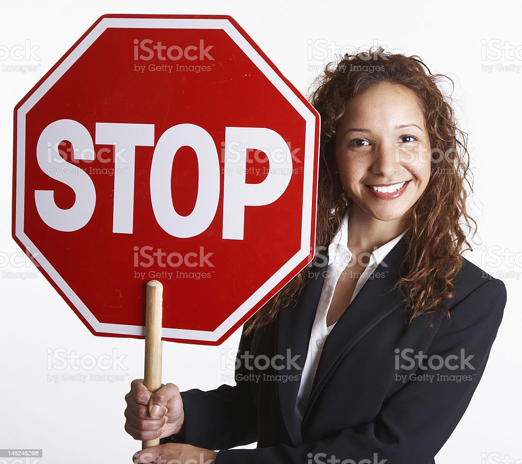 young business woman holding STOP sign stock photo