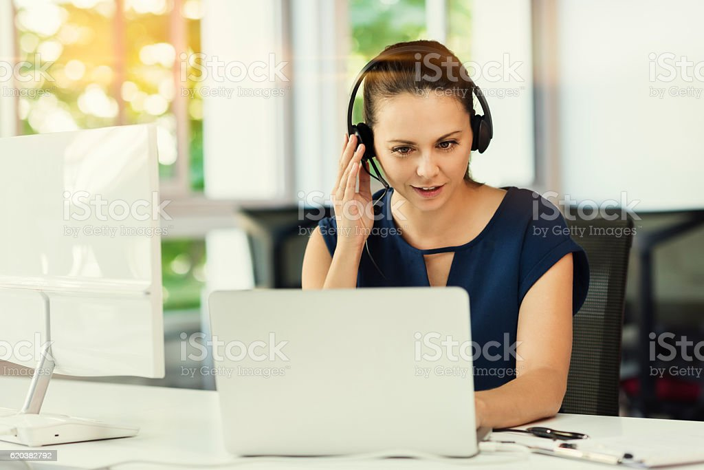 Young business woman in video conference at the modern office stock photo