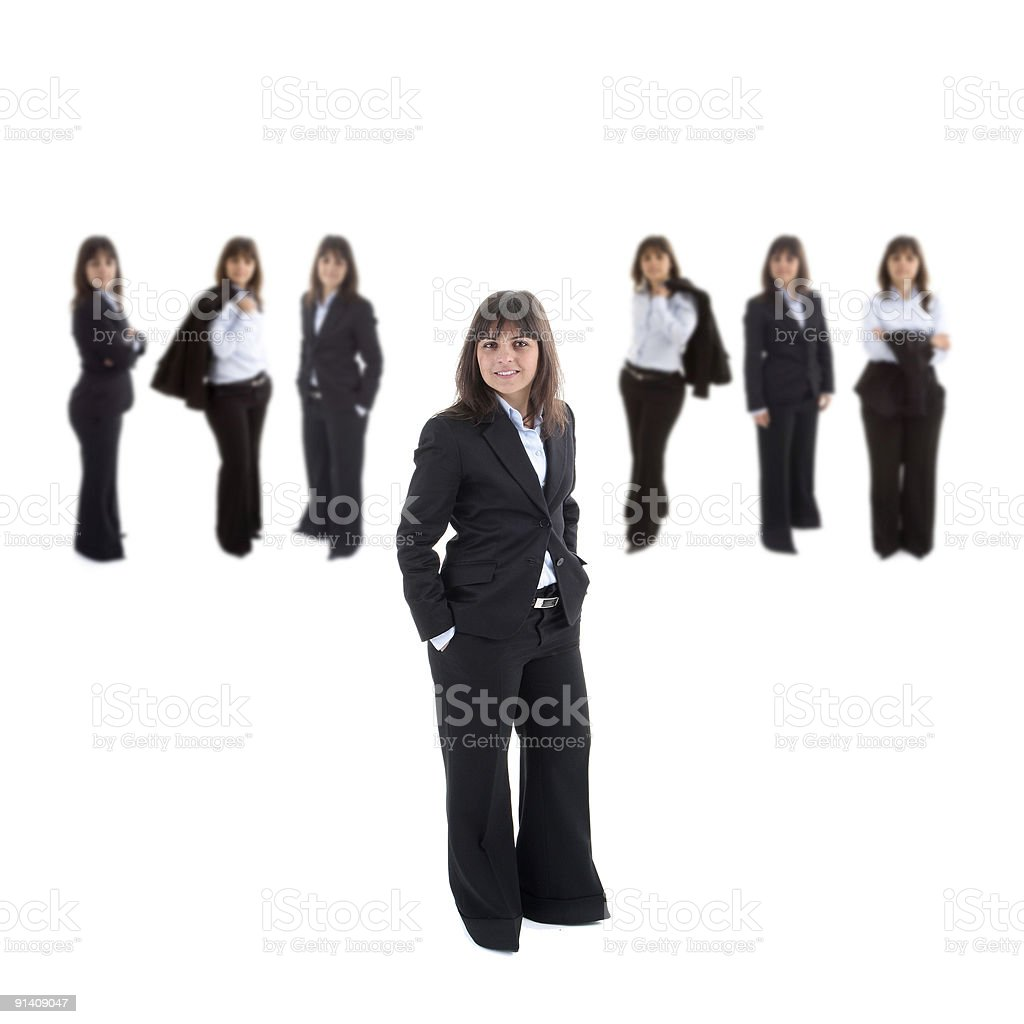 Young business woman leading a corporate team royalty-free stock photo