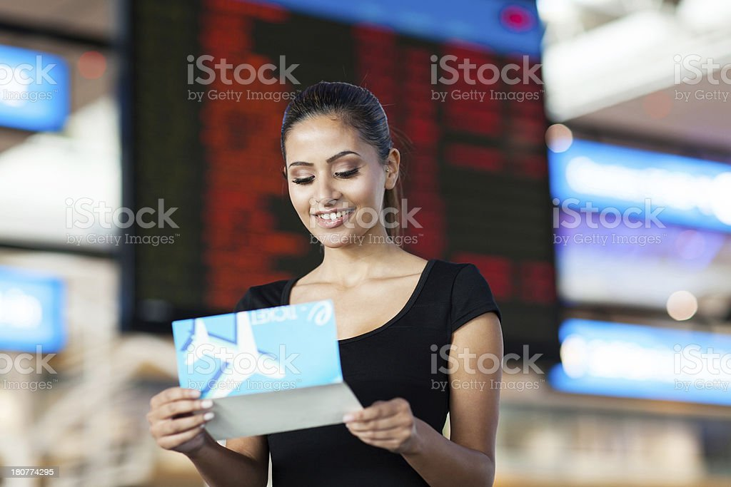 young business woman looking at air ticket royalty-free stock photo