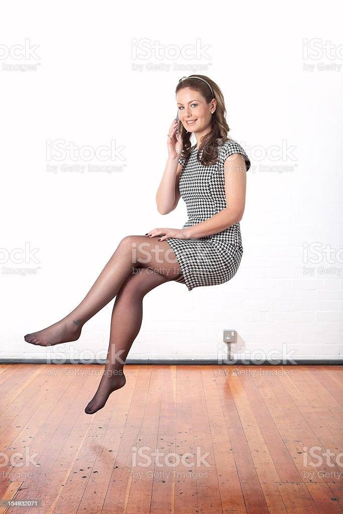 Young business woman making a phone call floating mid air stock photo
