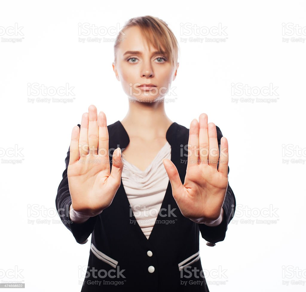 young business woman making stop desture stock photo