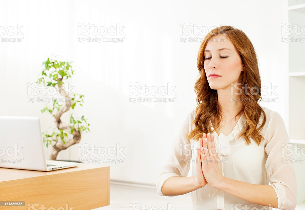 Young Business Woman Meditating at home. royalty-free stock photo
