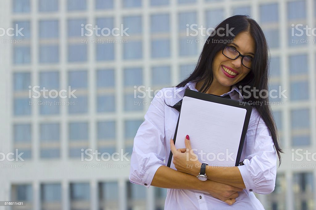 Young business woman on background of skyscraper stock photo
