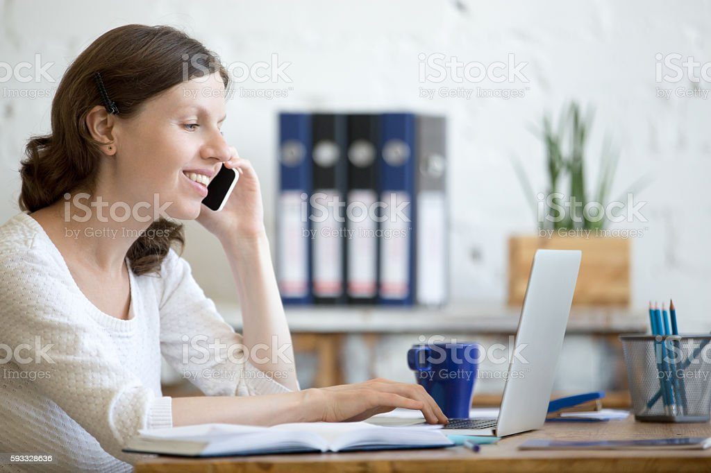 Young business woman on phone stock photo
