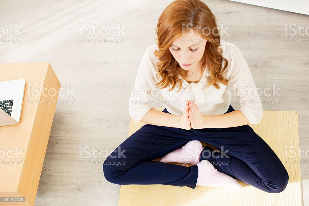 Young Business Woman Practicing Yoga at home. royalty-free stock photo