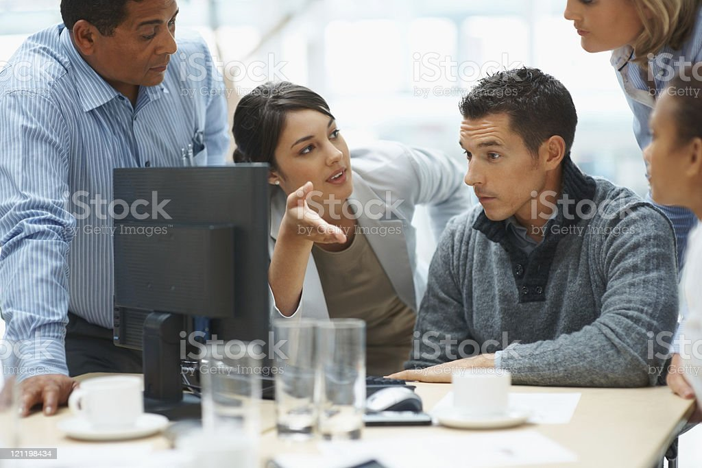 Young business woman presents ideas to her team stock photo